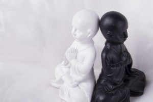 Beautiful little black & white buddha with lotus flower (white background studio)